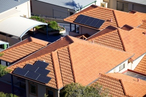 Solar Panels on the roofs of Australian Homes. Photo Source - http://www.flickr.com/photos/thelastminute/7461522300